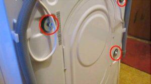 Где находятся транспортировочные болты на стиральной машине