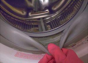 Грязь на уплотнительной резине стиральной машины