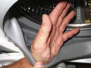 Порванная манжета люка стиральной машины