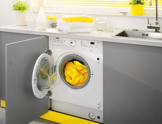Встраиваемая стиральная машинка в интерьере кухни