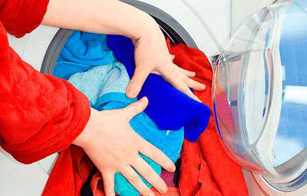Перегрузка стиралки бельем - одна из причин поломки подшипника